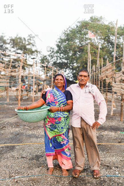 Udvada, India - September 9, 2020: Indian couple working in a traditional fishery