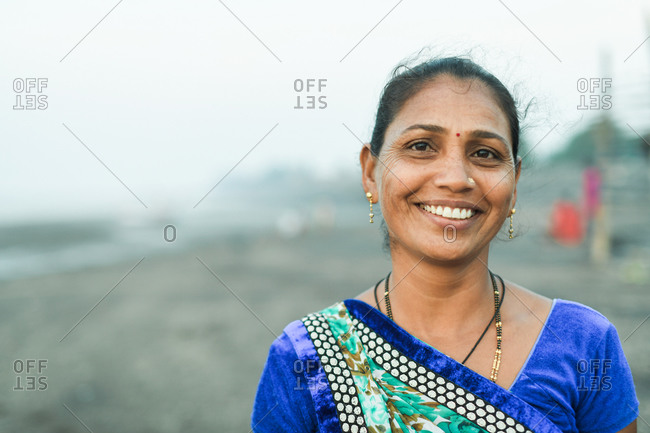 Udvada, India - September 9, 2020: Portrait of an Indian woman working in a fishery