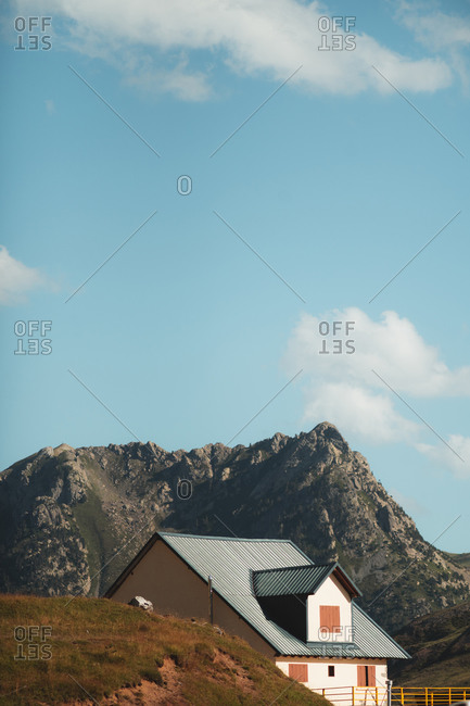 Mountain hut peeking between mountains