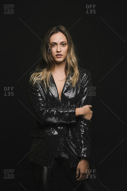 Woman in a suit at a New Year's Eve party