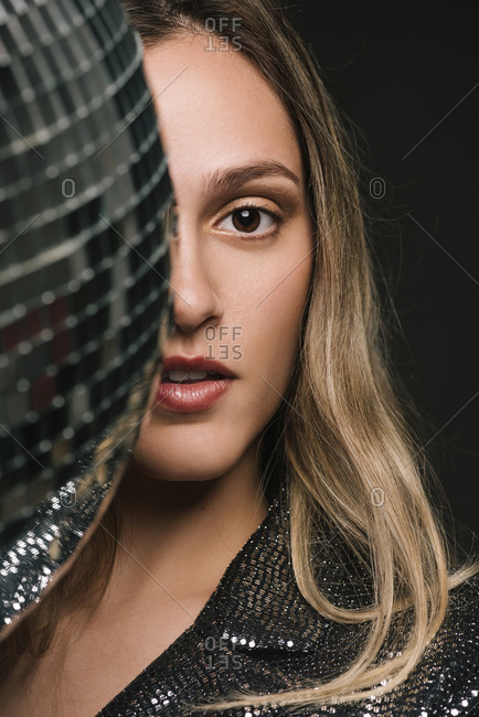 Close-up portrait of a woman with a disco ball at a New Year's Eve Party