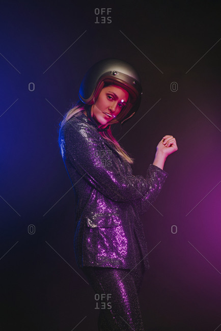 Conceptual portrait of a woman with a helmet and colorful lights