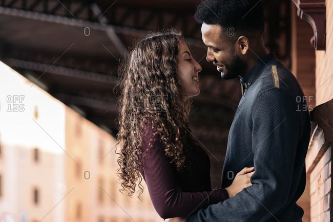 Happy moment of interracial couple in Madrid City