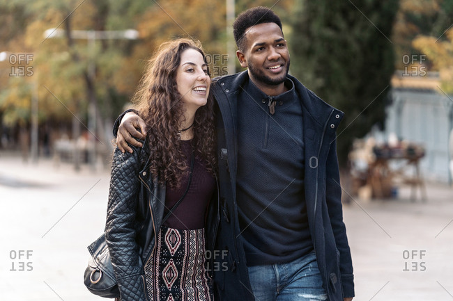 Happy interracial couple walking together