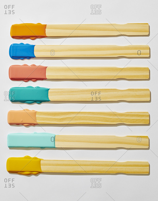 Organized Wooden Paint Paddle Stirrers Dipped in Paint