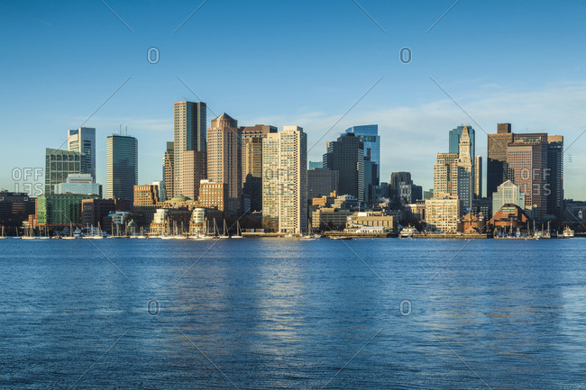 November 9, 2018: USA, Massachusetts, Boston. City skyline from Boston Harbor at dawn.