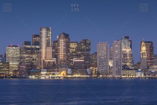 December 11, 2018: USA, Massachusetts, Boston. City skyline from Boston Harbor at dawn.