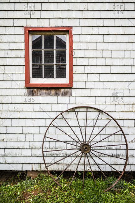 Canada, Prince Edward Island, Orwell. Barn with old wagon wheel.