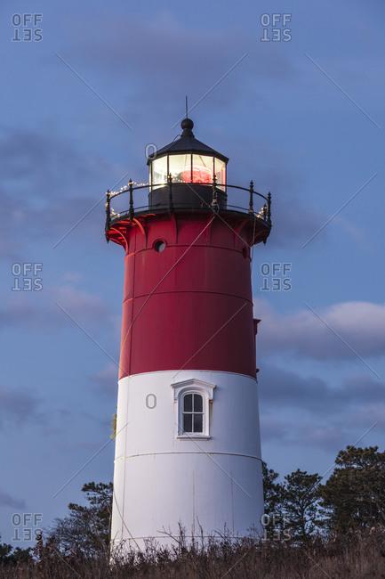 USA, Massachusetts, Cape Cod, Eastham. Nauset Light with Christmas wreath at dawn.