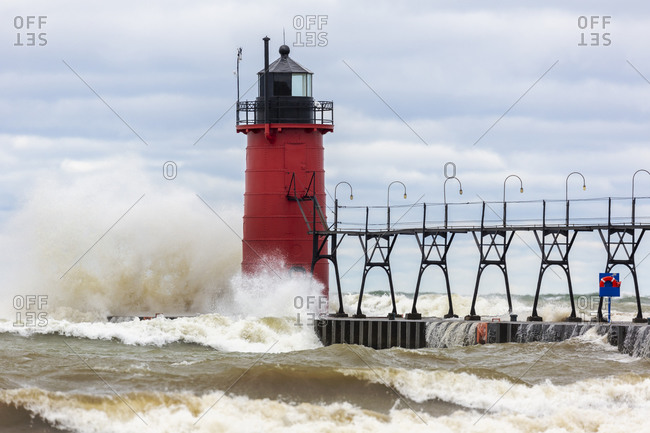 South Haven Lighthouse with high waves crashing, South Haven, Michigan.