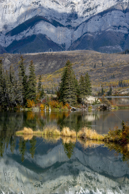 Canada, Alberta. Autumn reflections at Talbot Lake, Jasper National Park.