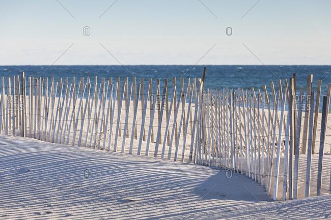 USA, Massachusetts, Nantucket Island. Madaket. Madaket Beach, sand fence and shadows.