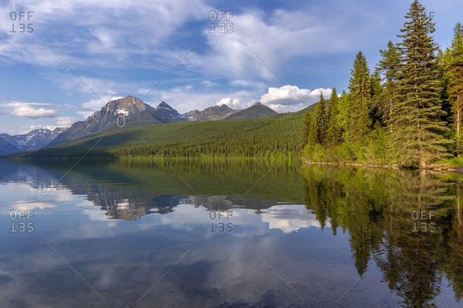 Calm reflection on Bowman Lake in Glacier National Park, Montana, USA