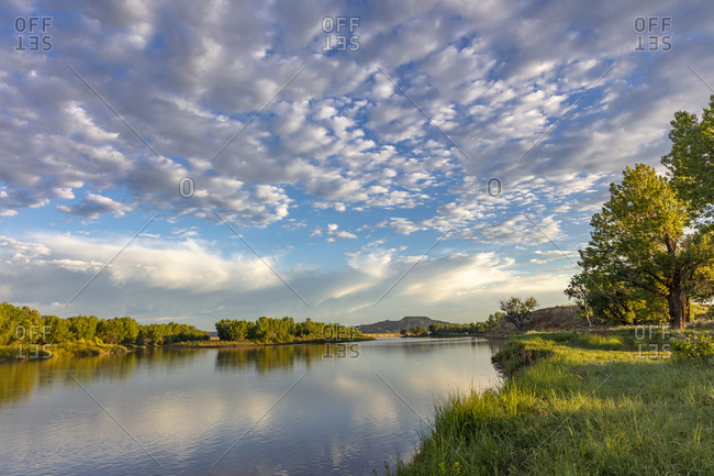 Sunrise and clouds over the Powder River near the confluence with the Yellowstone River near Terry, Montana, USA