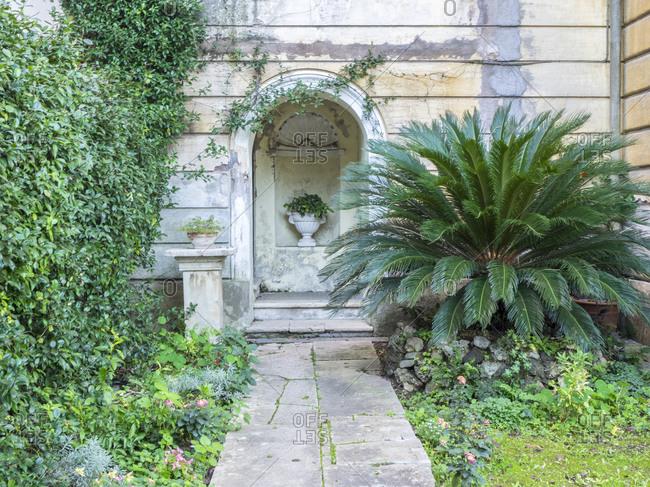 November 16, 2016: Planter in the archway of the Villa d'Este, Tivoli