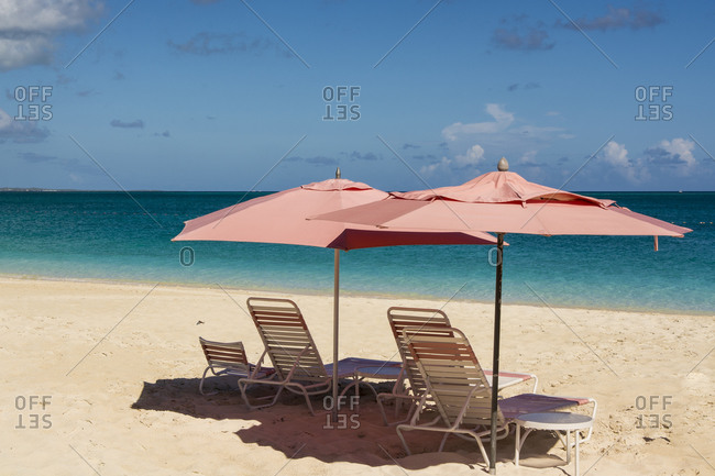 Beach umbrellas on Grace Bay Beach, Providenciales, Turks and Caicos Islands, Caribbean.
