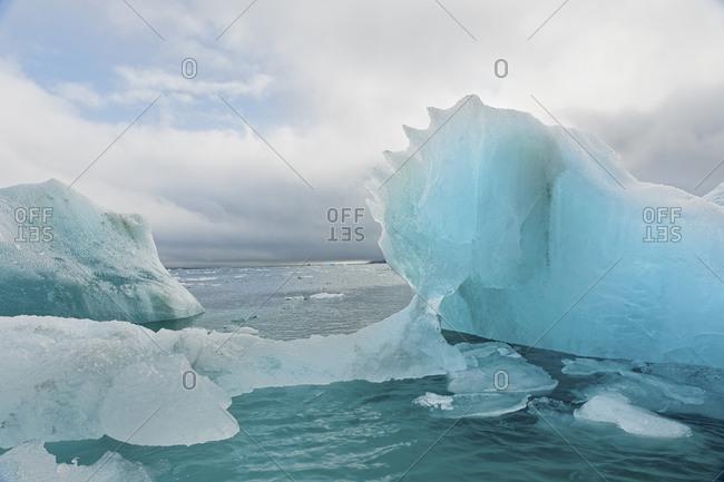 Iceberg adrift in the ocean, Svalbard, Norway.