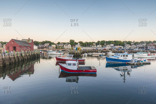 July 4, 2018: USA, Massachusetts, Cape Ann, Rockport. Rockport Harbor at dusk