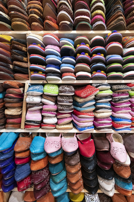 Africa, Morocco, Fes. Rack display of colorful shoes.