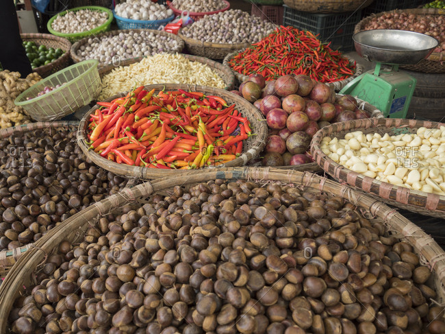 Vietnam, Hanoi, Old Quarter. Nuts, peppers, and other foods for sale.