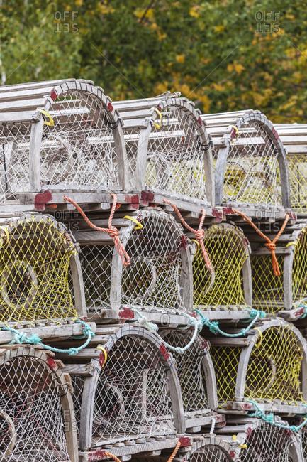 Canada, Nova Scotia, Cabot Trail. Ingonish Harbour, Cape Breton Highlands National Park, wooden lobster traps.