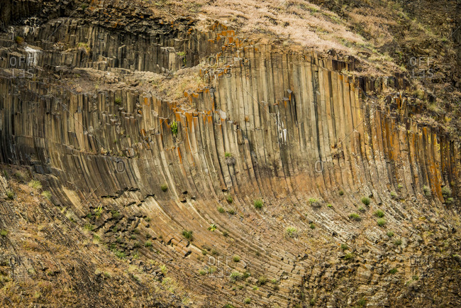 USA, Idaho. Hells Canyon, columnar basalt joining and Permian rhyolite dikes of the Columbia River Basalt Group.