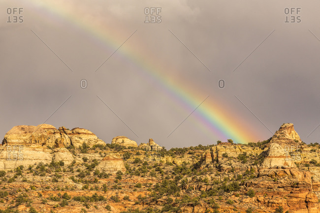 USA, Utah, Grand Staircase-Escalante National Monument. Mountain rock formations and storm rainbow.