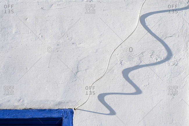 Africa, Morocco, Asilah. Wall shadow of wire.