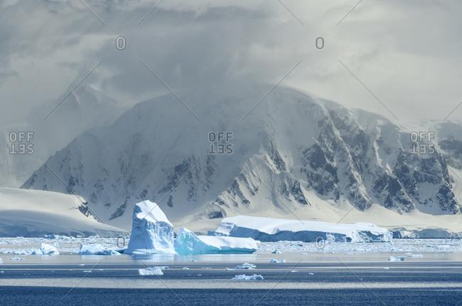 Antarctica, Antarctic Peninsula, Andvord Bay. Iceberg and mountain landscape.