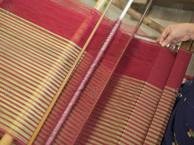 Vietnam, Phan Thiet. Close-up of weaving on a loom.