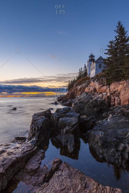 USA, Maine, Mt. Desert Island. Acadia National Park, Bass Harbor Head Lighthouse at dusk.