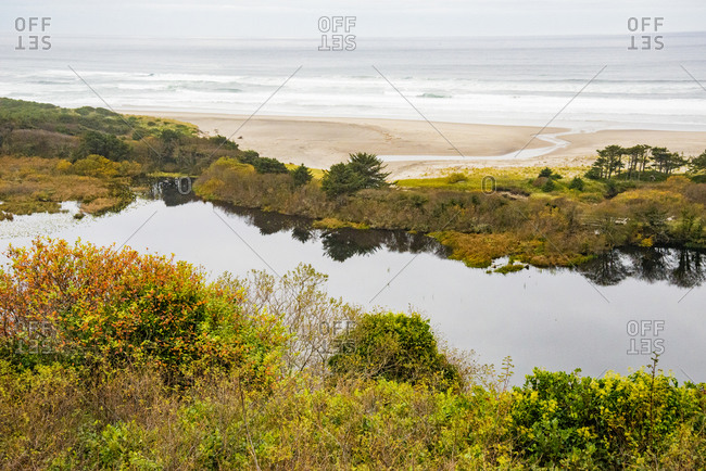 USA, Oregon. Overlook of slough and Pacific Ocean.