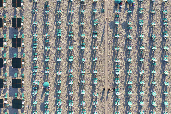 Italy, Tuscany, Torre del Lago Puccini, boathouse and neatly ordered beach chairs and umbrellas