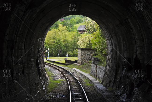 Narrow-gauge heritage railway track for the Sargan Eight train running through a tunnel, Mokra Gora, Serbia