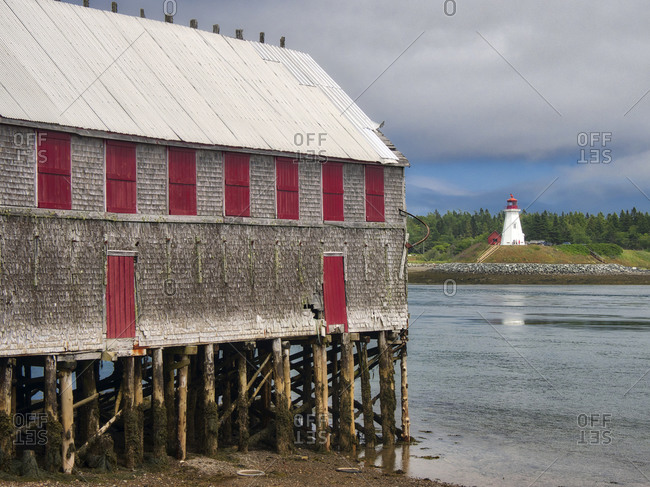 USA, Maine, Lubec. Mulholland Point Lighthouse as seen from the town of Lubec, Maine.