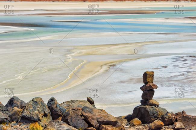 Laguna Salar de Talar with rock pile, San Pedro de Atacama, Antofagasta Region, Chile