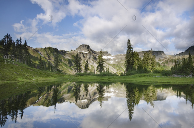USA, Washington State. Table Mountain reflected in small lake in Heather Meadows Recreation Area, North Cascades.