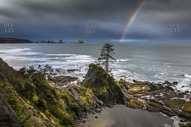 USA, Washington State, Olympic Peninsula. Shi Shi Beach, Rainbow over Point of the Arches.