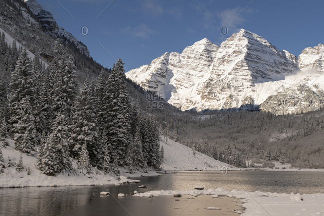 USA, Colorado, White River National Forest. Fresh snow on Maroon Bells.