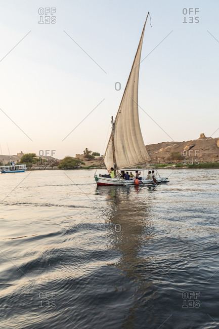 Africa, Egypt, Aswan. October 8, 2018. A felucca, a traditional wooden sailing boat, on the Nile river at Aswan