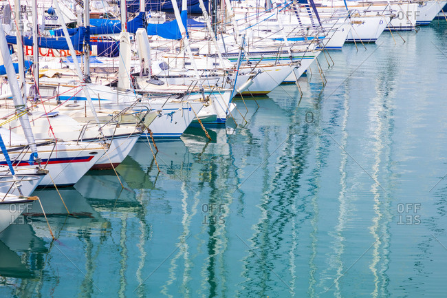 May 25, 2019: Province Of Barletta-Andria-Trani, Italy: White sailboats in blue water.