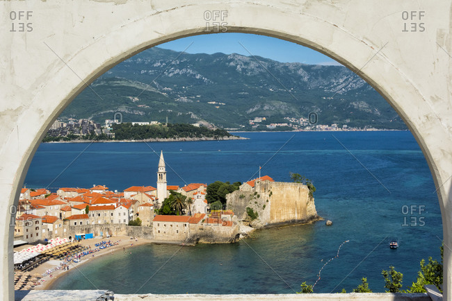 July 22, 2019: Tower of Saint Ivan Church and the old walled city along the Adriatic coast, Budva, Montenegro
