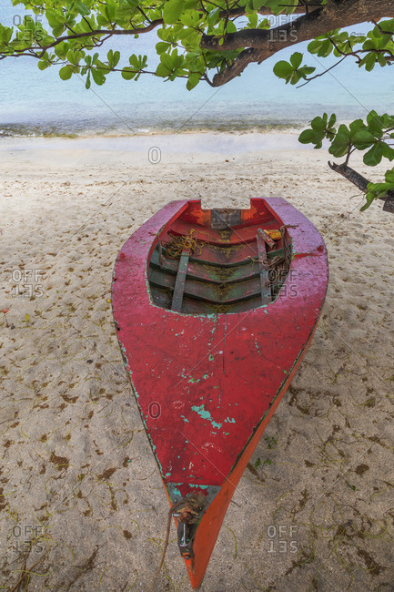 Caribbean, Grenada, Island of Carriacou. Wooden fishing boat on beach.