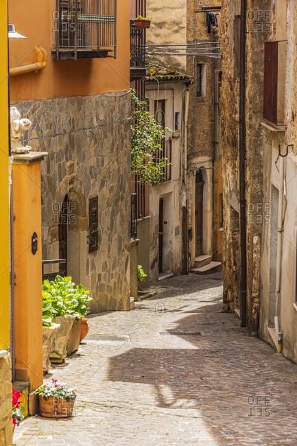Italy, Sicily, Messina Province, Caronia. A narrow cobblestone street in the hilltop village of Caronia.
