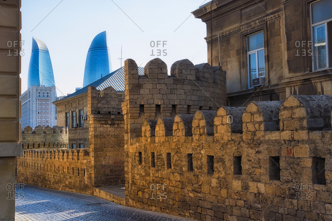 July 22, 2019: The Flame Towers with traditional houses in the Inner City of Baku, Azerbaijan