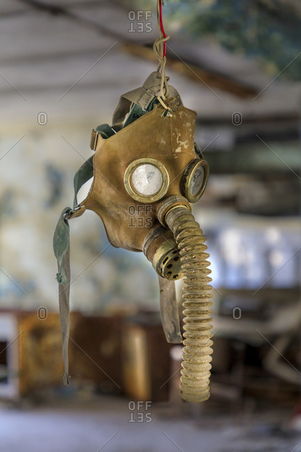 Ukraine, Pripyat, Chernobyl. Gas mask hanging from a wire.
