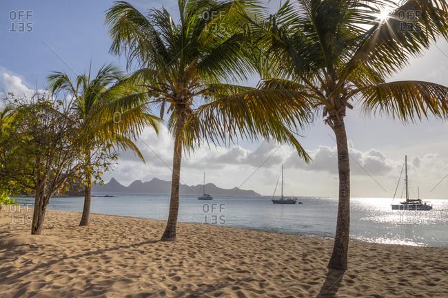 March 29, 2019: Caribbean, Grenada, Mayreau Island. Sailboats at anchor off beach.