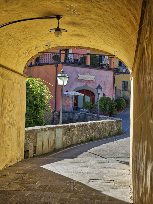 October 27, 2016: Europe, Italy, Chianti. Side street through an archway in the town of Radda in Chianti.