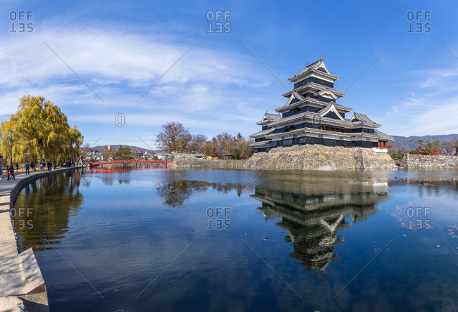 A sweeping view of Matsumoto Castle with its reflection in the moat, Japan