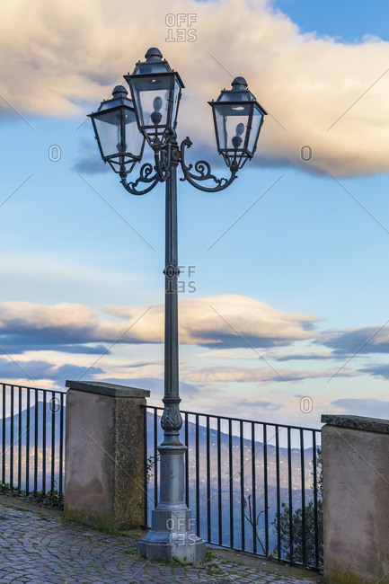 Europe, Italy, Sicily, Palermo Province, Pollina. Lamp post at sunset, at an overlook near the town of Pollina.